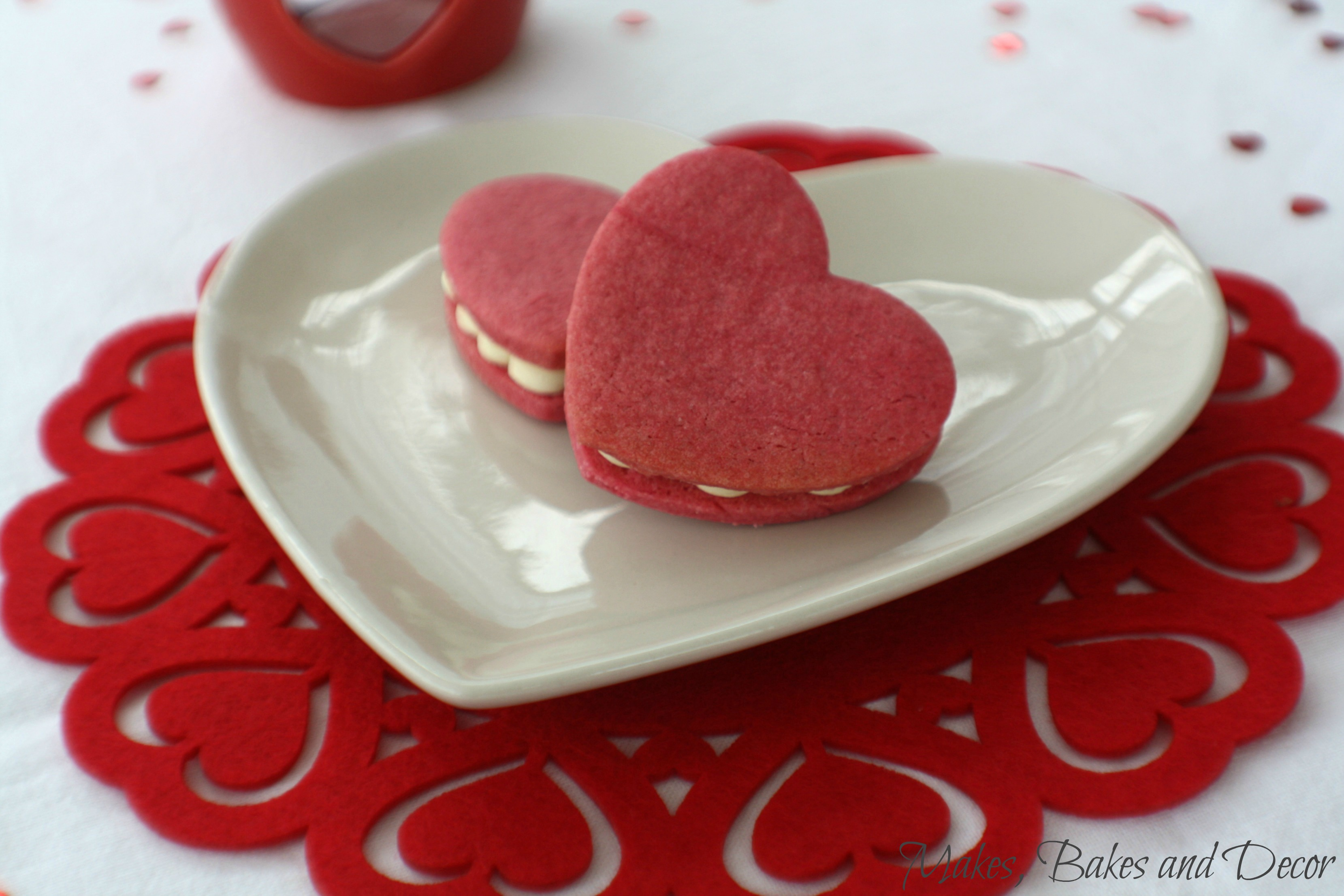 heart sandwich cookies with prosecco buttercream